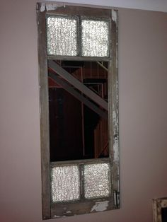 An great Hopscotch window keeping some of its original glass + hardware. available for purchase