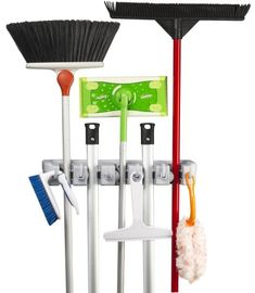 """A """"wall"""" organizer designed to hold various household objects with handles of varying thickness. Simply insert a handle into a slot and a rounded, gravity controlled, rolling ball automatically adjusts to the handle's thickness and grips it securely. Use in the laundry, garage, garden, utility room, offices, and more $10"""