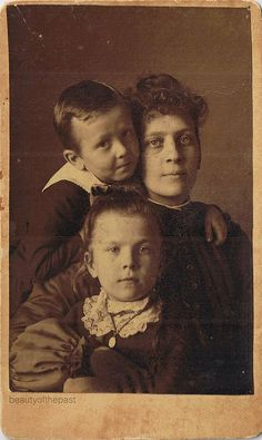 A very touching and intimate cdv portrait of a Victorian mother and her two children. Ca. 1900.