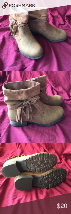 Tan booties with cute little fringes Brown/tan booties with cute little fringes around the ankles. Brand new, never worn. Mudd Shoes Ankle Boots & Booties