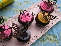 Chocolate butterflies and even names.  Made with chocolate chips or any melting chocolate you want to use.