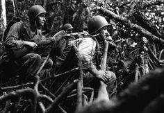 """Infantrymen of Company """"I"""" await the word to advance in pursuit of retreating Japanese forces on the Vella Lavella Island Front, in the Solomon Islands, on September 13, 1943. (U.S. Army)"""