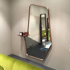 Asymmetric mirror with integrated shelf by Porada