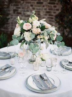 wedding centerpieces with pink flowers - photo by Christina Pugh http://ruffledblog.com/fall-wedding-inspiration-from-the-big-fake-wedding
