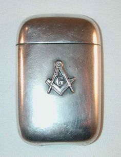 "Description: Antique pocket match safe, matchsafe or vesta made of sterling silver. This match safe has a raised Masonic or Mason emblem on the front consisting of a compass and angel with a ""G"" in th Más Vintage Silver, Antique Silver, 925 Silver, Sterling Silver, Silver Jewelry, Silver Rings, Vases, Art Nouveau, Cool Lighters"