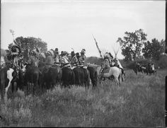 The parade of victory. A group of Native American men on horses some wearing feather headdresses riding beside several tipis. Collection Richard Throssel. Indian reservations--Montana. Date Original: 1902-1933. University of Wyoming. American Heritage Center.