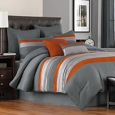 Achieve a sleek look in your bedroom with the Livingston Comforter Set. With the sophisticated color combination of greys and deep orange, mixed fabrication of microfiber, faux silk, and herringbone texture, the set adds a modern touch.