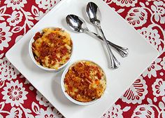Bacon-Lobster Mac and Cheese:     ½ pounds Macaroni     5 slices Bacon, Chopped     1 clove Garlic, Minced     ½ whole Onion, Chopped     2 whole Lobster Tails, Meat Diced And Save The Shells     ½ quarts Heavy Cream     1 cup Gruyere Cheese, Grated     1 cup Cheddar Cheese     2 whole Eggs     Salt And Pepper