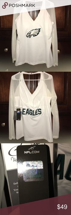 An official NFL women's shirt This is an authentic NFL eagles shirt size XL supper sexy with cut out back and shear sleeves NFL Tops Tees - Long Sleeve