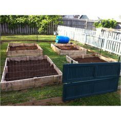 Our mostly up-cycle garden! Pallets for the raided beds, old shutters for the gate, old fence pickets for the bottom border and a plastic barrel Justin made into a rolling compost bin.  Can't wait to get plants in it!