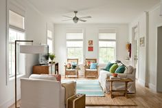 To enhance the home's 9-foot ceilings, these homeowners upgraded to 8-foot-tall doors and 6-foot-tall windows to let in maximum light. They also aligned the doors and windows at the same height to draw the eye up and create the illusion of more space.  See this Pre-Fab Coastal Cottage