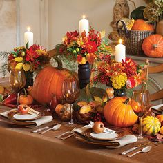Welcome family and friends with a warm autumn tablescape that captures the essence of fall color. These floral arrangements blend fiery shades of gold, mustard, orange, and red taken from nature's bounty. Candle cups are secured to the top of the candlesticks with waterproof floral tape