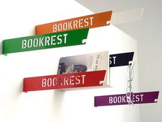 Mounted metal book rest that you hang on the wall, to keep your place when you stay up late and are without a bookmark. There's even a small hook so you can keep track of your reading glasses