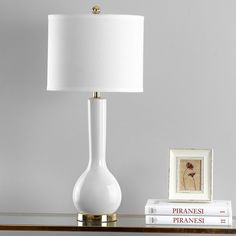 Bookend your bed with a pair of these vase-like lamps to round out the master suite, or set one on a side table to stylishly illuminate a seating group.