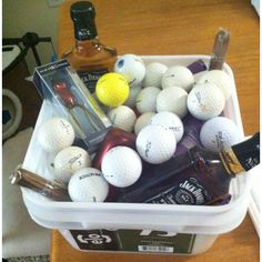 Man basket - use tub of golf balls for basket, include cigars, whiskey, tie, beef jerkey, sports fan items, dr pepper 10...anything men like!