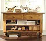 Got this console table for my TV stand. It has cut outs for the cords and works well in the living room.  Pottery Barn
