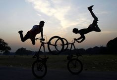 TUESDAY, DECEMBER 2: HIP-HOP CARNIVAL Cyclists perform a stunt as they practice ahead of the Hip-Hop Carnival in Kolkata, India, on Dec. 2, 2014.