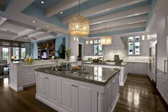 KITCHEN: Beautiful blue kitchen. Love the beam ceiling, light fixtures and endless counter space. #home #interior #design
