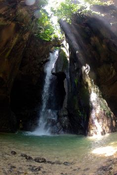 repelling down waterfalls in moalboal, philippines