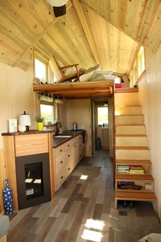 The Tiny Om is a tiny house built by Lyons, Colorado-based SimBLISSity Tiny Homes. The Tiny Om features a propane fireplace. Tiny House Cabin, Tiny House Living, Tiny House Design, Tiny House On Wheels, Small House Plans, Living Room, Small Living, Cabana, Small Home Offices