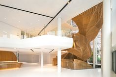 the unit spans four stories and is penetrated by a soaring staircase that serves as the centerpiece of the design.