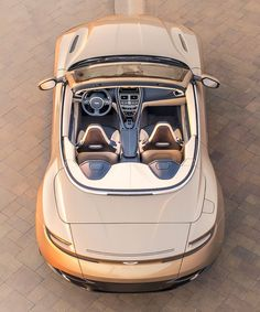 the aston martin volante sets new standards of performance, innovation, engineering and style to create a definitive open-top sports car. Aston Martin Lagonda, Carros Aston Martin, Aston Martin Db11, Luxury Car Logos, Best Luxury Cars, Maserati, Bugatti, Ferrari, Top Sports Cars