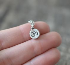 This Dainty Om Necklace was created with a 9mm x 7mm om symbol charm attached to a delicate 18 inch chain with clasp. Choose from Antique Silver or Bronze finish. This necklace is a perfect piece worn