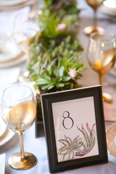 Gold and white tablescape with framed table number