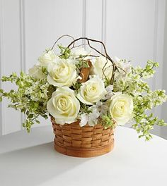 FTD Peaceful Garden Basket - PREMIUM  $82.90  The FTD Peaceful Garden Basket offers warmth and comfort through its display of snow-white blooms. Roses, larkspur and Peruvian lilies are accented with curly willow tips and an assortment of lush greens.