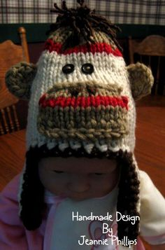 I loom knitted this sock monkey hat on one of my Knifty Knitter looms. I didn't have a pattern...it is a copy of a needle knitted hat by Backwoods Knifty Knits... I did crochet the ears.