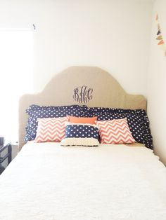 Monogram burlap headboard and chevron and polka dot pillows!