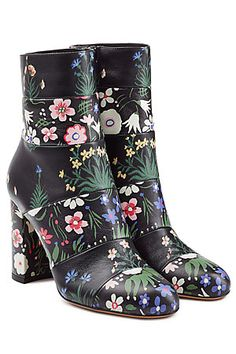 Printed with Celia Birtwell's signature happy blooms, Valentino's black leather ankle boots are a statement choice with soft feminine appeal #Stylebop