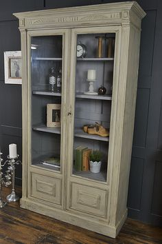 This pretty glass display cabinet/bookcase sourced just outside of Paris has a real rustic French charm. With a grey paint wash on the outside and a warm grey highlighting the inside shelves, this detailed piece would make an attractive addition to any room. http://www.thetreasuretrove.co.uk/cabinets-and-storage/shabby-chic-french-grey-glass-display-cabinet
