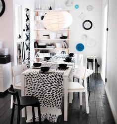White SIGURD chairs fit seamlessly in this cozy, modern black and white dining room