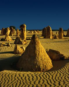 Check out 'The Pinnacles', found in Nambung National Park in Western Australia. It's believed these unusual limestone structures formed thousands of years ago from the deposits of sea shells. Some stand as high as five metres! Perth Western Australia, Australia Travel, Nambung National Park, Places To Travel, Places To Visit, Snorkeling, Parque Natural, Western Photography, Gaia