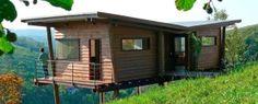 Lien permanent vers Maisonnette en bois sur pilotis sur une colline verdoyante au Brésil