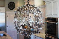 Sara's Kitchen Tour: Part 1 Camila Globe light from Pottery Barn..also has chandeliers that coordinate