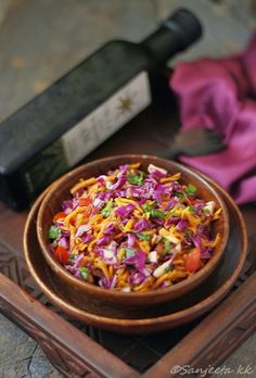 Indian cole slaw, cabbage, carrot, cucumber, tomato, onion, cilantro, sesame seeds, oil, honey, lemon juice salt & pepper.
