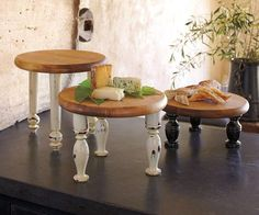 Old Thrift Store Cutting Boards...re-purposed into great risers for your table.  Add cute legs or old spindles to a cutting board...these would be great for a buffet table for different heights or a cake stand!!