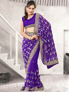Look bold and #fashionable in this blue colored #saree. This #saree is crafted in #Georgette material. It is beautifully designed with well crafted #embroidery work on the border. The #gorgeous #embroidery work on the border and the #designer blouse gives it a #fabulous look. It can be worn at any occasion to become the center of attraction. (Slight variation in color is possible)