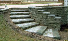 curved retaining wall ideas | The tread was built using Moss Creta Wall Capstone and a custom ...