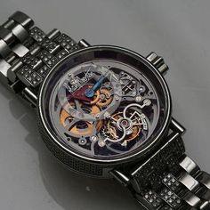 """Alain Silberstein """"Nomade"""" Tourbillon Rare, fun, diamond-studded steel tourbillon watches from Alain Silberstein. Estimate: $40,000 - 45,000"""