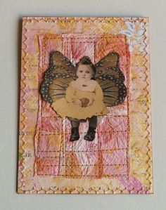 Mixed media card by Peppina. Picture is a freebie from Rubyblossom. Background is made of paper towel strips stained with paint/inks, and then sewn together.