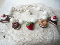 sweet and pretty bracelet made of polymer clay and quartz faceted beads.  features a strowberry, two biscuit and two slices of cake ❤  every charms is handmade with love and attention to detail ❤  a little metal heart is hanged at the end of the chain.