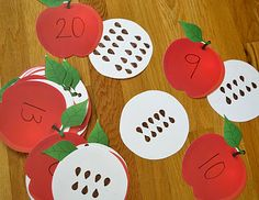 These paper apples are some of those teacher die cut sets. The white parts are just white paper circles with seeds drawn on. Great for counting and number recognition.