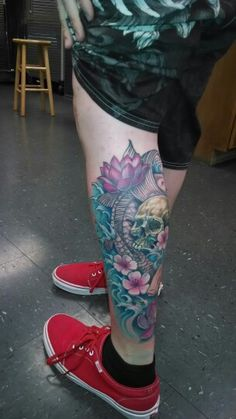 Calf Color tattoo, skull, koi fish, lotus flower, cherry blossum,