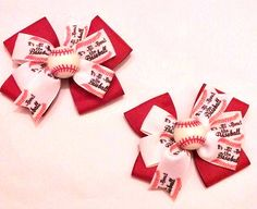 *FREE SHIPPING ON ORDERS OF $20 OR MORE. USE CODE 20FREESHIP AT CHECKOUT This listing is for a set of two bows, pigtail set. The double stacked bows feature red ribbon topped with Its All About The Baseball printed ribbon. Each bow is embellished with a baseball center. Bows are approx. 3 each. All ribbon ends are heat sealed to prevent fraying  can be attached to your choice of single prong alligator clip or barrette. All bows can be added to a headband at request. Headbands are an…