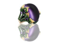 Emily H London Emilia ring featuring an amethyst centerpiece held in place with four 18ct gold leaves set with tsavorites and yellow diamonds