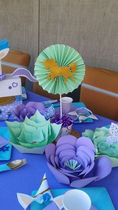 A great purple and mint DIY centerpiece at this Unicorn inspired birthday party! Just look at those beautiful paper flower!! See more party ideas at CatchMyParty.com