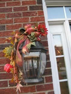 This so looks like my Christmas light decorations with a fall twist! Fall Decor for your outdoor lighting.